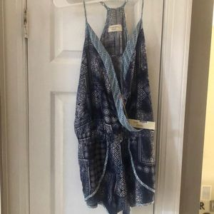 New with tags, adorable romper.